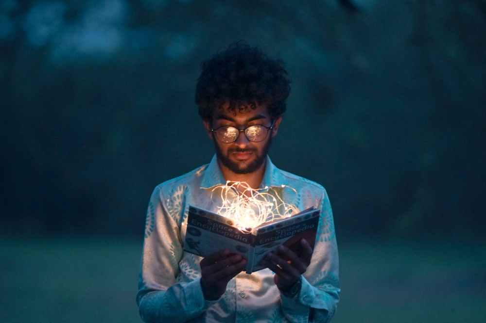 man holding book